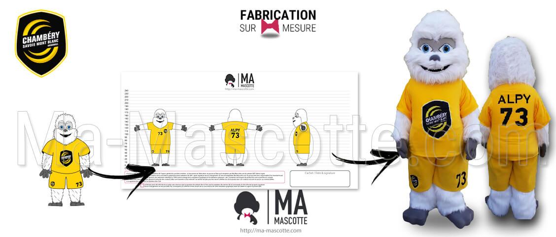 Yeti mascot made in white faux fur for the Chambéry Savoie Mont Blanc handball. Professional yeti mascot for sport.